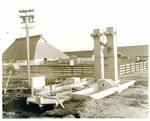 Agricultural Machinery - Calif - Stockton: Rex grain elevator with tractor in the background