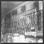 Meat Industry and Trade - Stockton: Interior view of slaughter house with workmen and slabs of meat [beef]