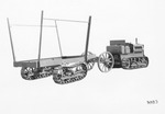 Crawler Tractors - Stockton: Caterpillar tractor towing a trailer equipped with caterpillar tracks