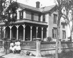 Dwellings - Stockton: [Home of Andrew Simpson, children in front, El Dorado St. and Oak St.]
