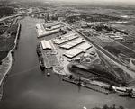 Stockton - Harbors - 1970s: Stockton port looking east toward head of channel, completion of Interstate 5 bridge