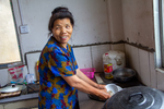 Wu Mnci washing dishes in Duan Wenbin's home by Marie Anna Lee