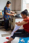 Wu Hanmei embroidering and Wu Mnci washing dishes by Marie Anna Lee