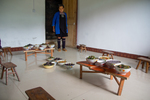 Wu Yingniang in room with lunch for all helpers on traditional low half tables by Marie Anna Lee