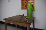 Altar at Wu Gaitian's home with water and toys by Marie Anna Lee
