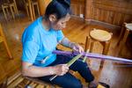 Repairing backstrap loom by Marie Anna Lee