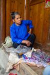Wu Yingniang looking at fabrics by Marie Anna Lee