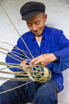 Wu Zhenguo weaving a basket by Marie Anna Lee