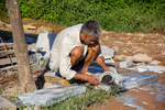 Man cutting stone by Marie Anna Lee
