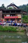 Crowds from other villages visiting for a volunteer firefighter competition by Marie Anna Lee