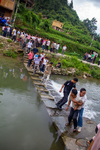 Men crossing the shallow weir by Marie Anna Lee
