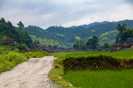 Landscape of a road near hills and mountains by Marie Anna Lee