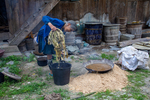 Wu Meitz pulls mulberry bark out of water by Marie Anna Lee