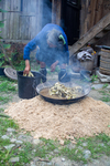 Wu Meitz putting mulberry bark in wok by Marie Anna Lee