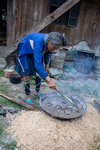 Stirring mulberry bark with bamboo by Marie Anna Lee