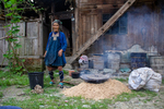 Artisan Wu Meitz with cooking mulberry bark by Marie Anna Lee