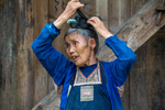 Wu Meitz putting hair up by Marie Anna Lee