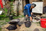 Taking liquid from cooked paper pulp to use in indigo vat by Marie Anna Lee