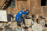 Pouring liquid from cooked paper pulp into indigo vat by Marie Anna Lee