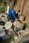 Taking liquid from spent indigo vat by Marie Anna Lee