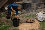 Putting mulberry bark into a wok by Anastasya Uskov