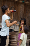 Woman and children drinking soda by Marie Anna Lee