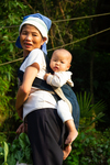 Woman using unadorned baby carrier by Marie Anna Lee