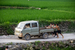Men pushing truck by Marie Anna Lee