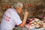 Selling pork in Liping by Marie Anna Lee