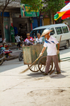 Street cleaner in Liping by Marie Anna Lee