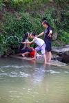Kids near water by Marie Anna Lee