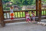 Children and dog on bridge by Marie Anna Lee