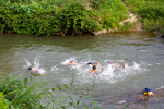 Kids swimming in river by Marie Anna Lee