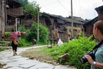 Woman carrying firewood by Anastasya Uskov
