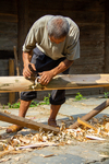 Man planing a beam by Marie Anna Lee