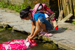 Washing laundry by Marie Anna Lee