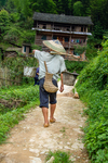 Man carrying buckets on a pole by Marie Anna Lee