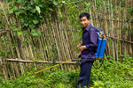 Man spraying insecticide by Marie Anna Lee