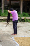 Woman combing hair by Marie Anna Lee