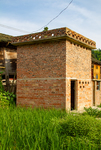 Brick building by Marie Anna Lee