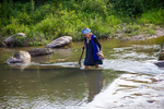 Woman crossing river by Marie Anna Lee