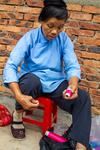 Preparing thread by Marie Anna Lee