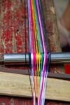 Warp on backstrap loom by Marie Anna Lee