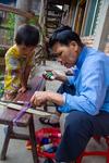 Wu Mnci warping the backstrap loom by Marie Anna Lee