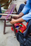 Tying the knot to finish the backstrap loom warping by Marie Anna Lee