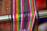 Taking warp off the warping bench by Marie Anna Lee