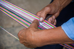 Spacing out warp on shed rod by Marie Anna Lee