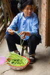 Cleaning string beans by Marie Anna Lee