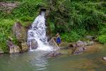 Fisherman reeling in net by Marie Anna Lee