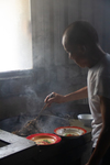 Wu Fengxiang cooking meat by Marie Anna Lee